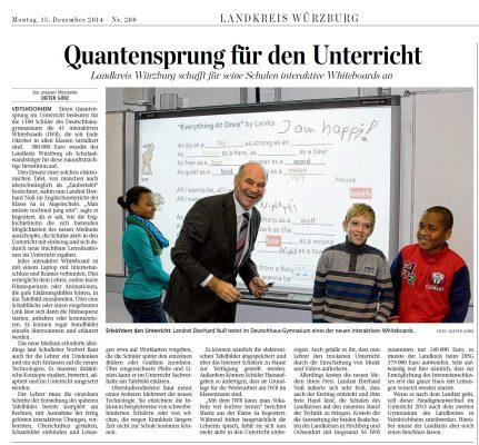 """Zeitungsausschnitt mit dem Titel """"Quantensprung für den Unterricht"""" . Auf dem dazugehörigen Foto sieht man einen Landrat mit sehr guter Laune"""