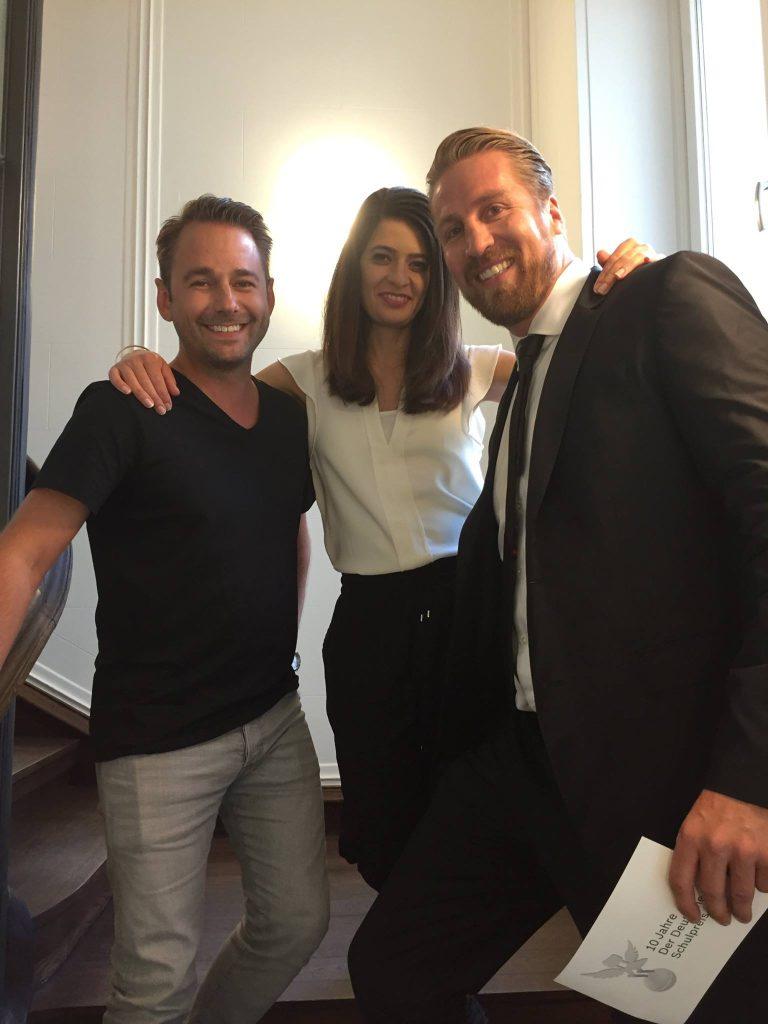 Drei freundliche Menschen